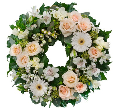 Round funeral wreath with fresh flowers
